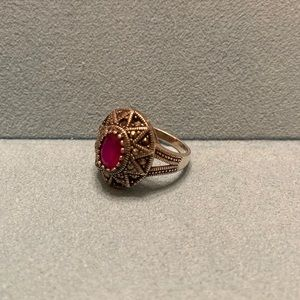 Silver ring with zircons and raw ruby